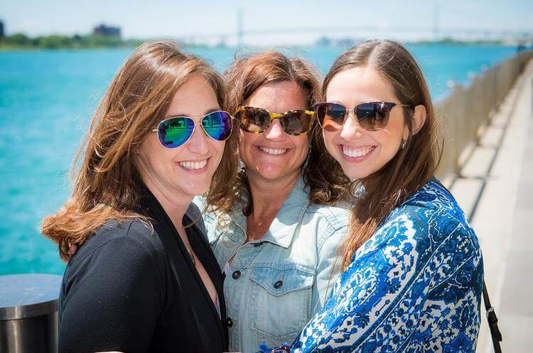Becca, Shannon and Danielle enjoying the sunshine at Cobo Hall. Photo by Paul Stoloff.